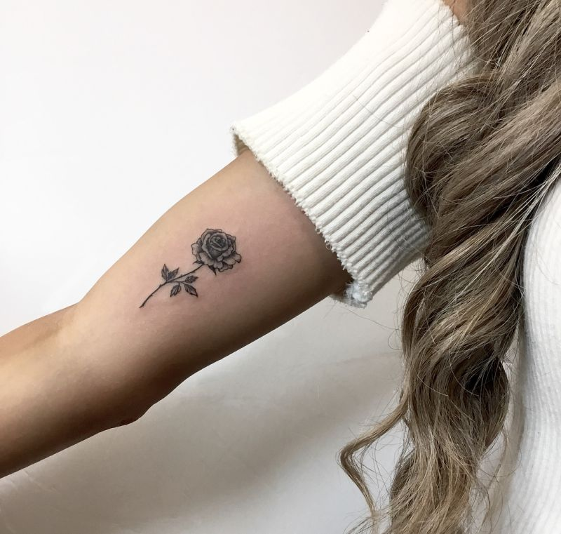 minimalist rose tattoo design