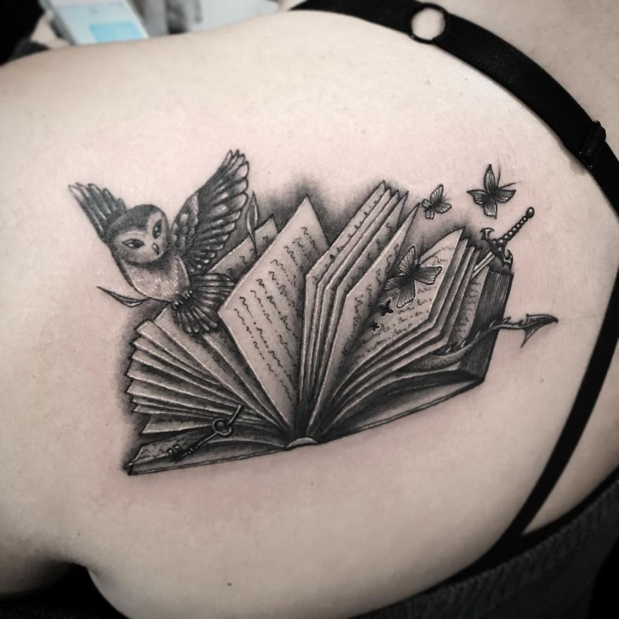 black and gray book tattoos