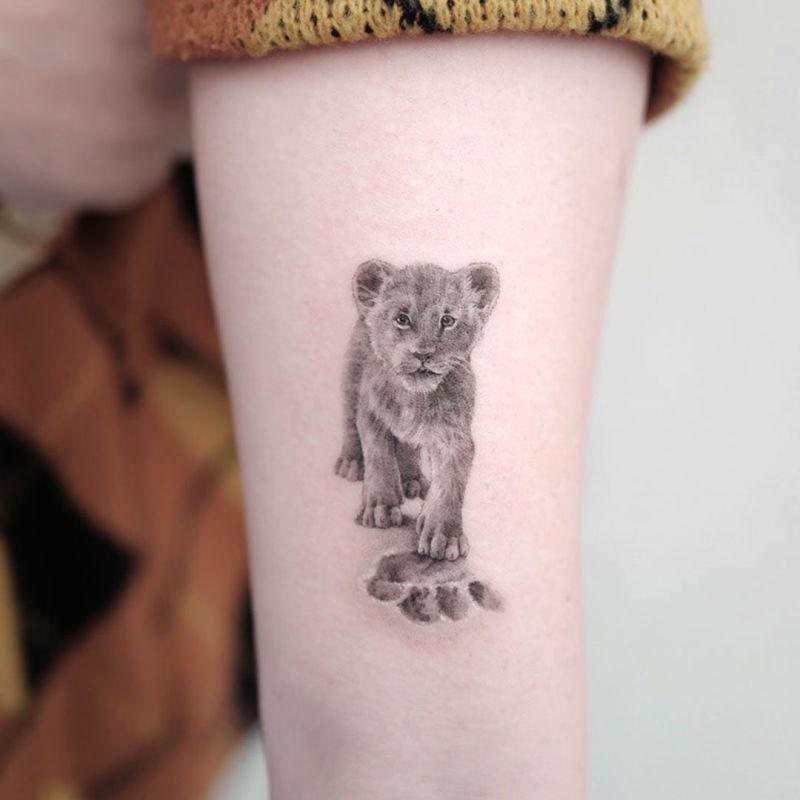 super cute lion cub tattoo