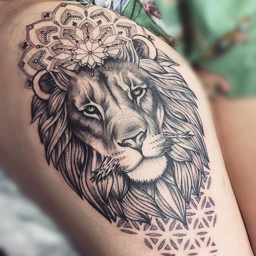 feminine lion tattoo