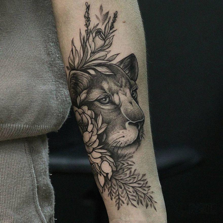 floral lioness tattoo