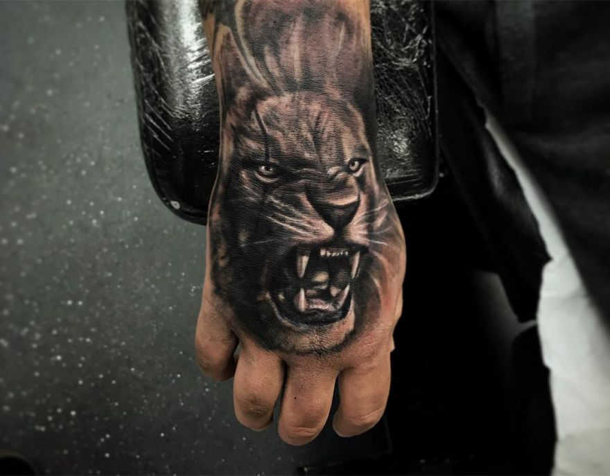 hand lion tattoo