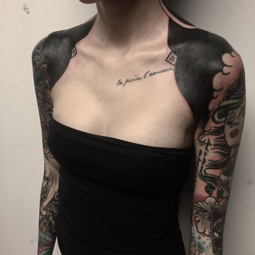 5effab0e9 These Striking Solid Black Tattoos Will Make You Want To Go All In ...