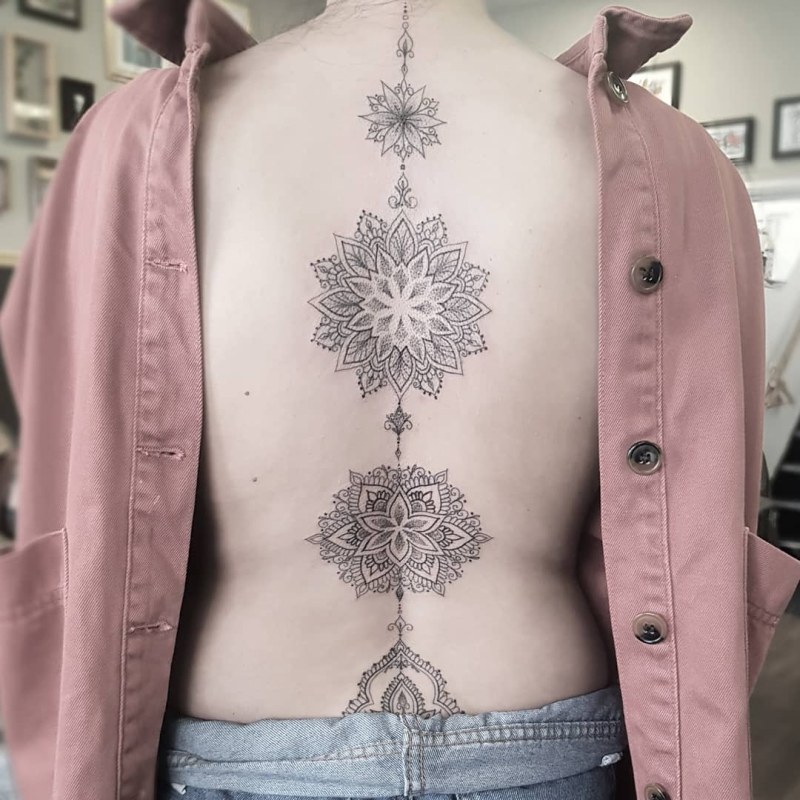 ornamental spine tattoo